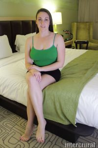 Melanie Hicks sit on the bed